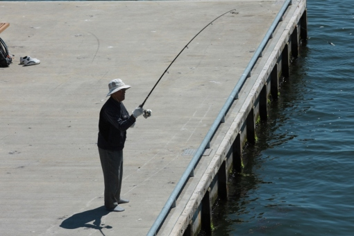 This old guy was fishing without his shoes on.