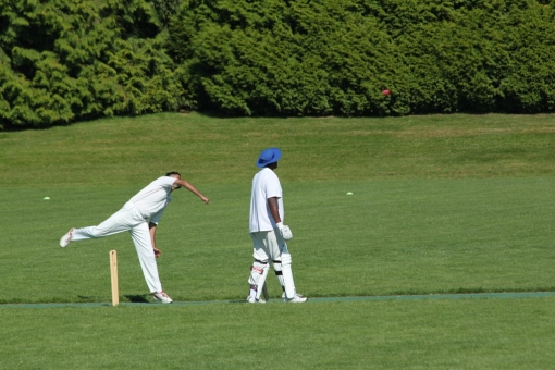An optical illusion! He's not really tripping over the wicket.
