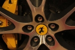 Ferrari wheel - not a Fiat. Not presented horizontally. You care? Who the hell are you?