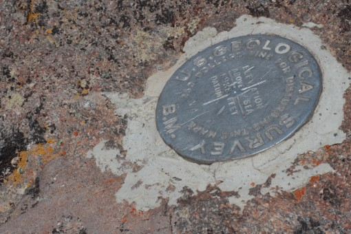 USGS marker declaring the height to be 8938' above sea level